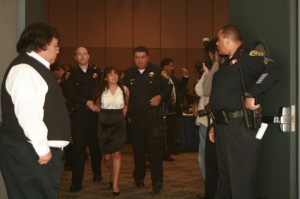A student is escorted out of the Regents meeting at UCLA on Wednesday. Photo by Nita Rose-Evans.