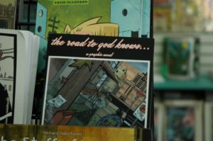 """""""The Road to God Knows"""" tracks the life of teenage protagonist Marie as she deals with her mother's schizophrenia. It is just one of many comic books and graphic novels lining the shelves of Atlantis Fantasyworld, located on Cedar Street. Photo by Kathryn Power."""