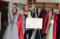 Pamela Whittington, the owner of Classic Cleaners, shows a few of the donated prom dresses in this year's prom dress drive. The drive provides for high schoolers who cannot afford them. This annual event will be accepting donations throughout the month of February until March 31. Photo by Molly Solomon.