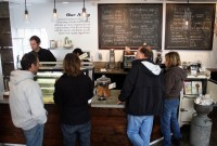 Patrons throng Penny Ice Creamery's counter on an unseasonably warm January afternoon. Kendra Baker and Zachary Davis, the shop's owners, are back operating their business after attending the State of the Union Address. Photo by Prescott Watson.