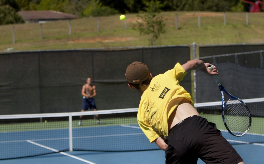 Freshman Bryce Bettwy serves a ball during a practice on Tuesday. Photo by Prescott Watson.