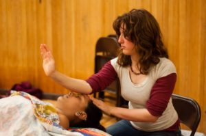 Students learn Swedish massage technique through giving each other massages in the Holistic Health Program. Photo by Daniel Green