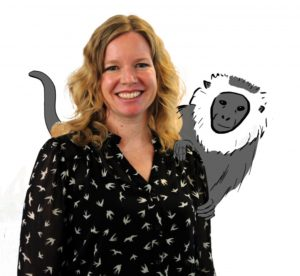Julie Teichroeb pictured above with an illustration of an ursine colobus monkey on her back. Photo-Illustration by Sal Ingram and Christine Hipp
