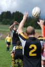 Austin Brown throws the ball into a lineout in the men's rugby team's last game at home for the year against Fresno State. Photo courtesy of Andrew Nakamura.