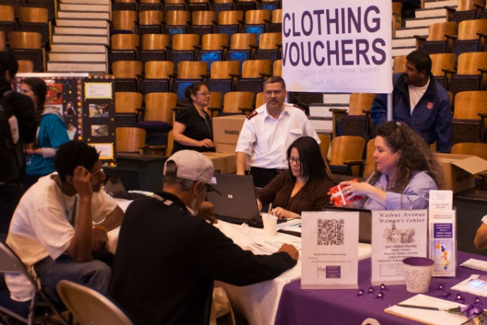 Clothing vouchers were provided to the homeless at one of the tables during the Project Homeless Connect event. Photo by Daniel Green.