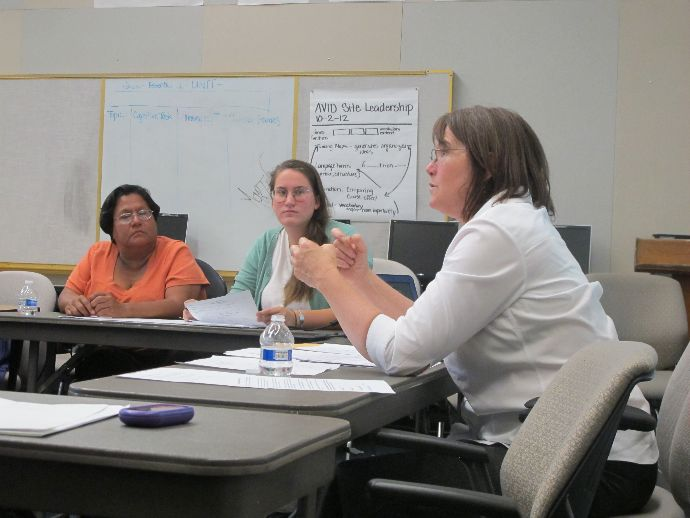 KAREN MALLORY trains volunteers for the June 1 Santa Cruz County Immigration Project DACA clinic. Photo courtesy of Anne Martinete.