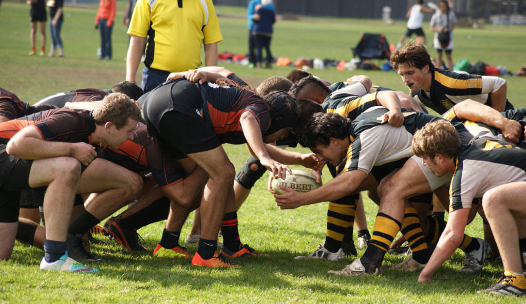 UCSC and UOP forwards formed a scrum to fight for possession during their game last weekend. Photo by Daniela Ruiz