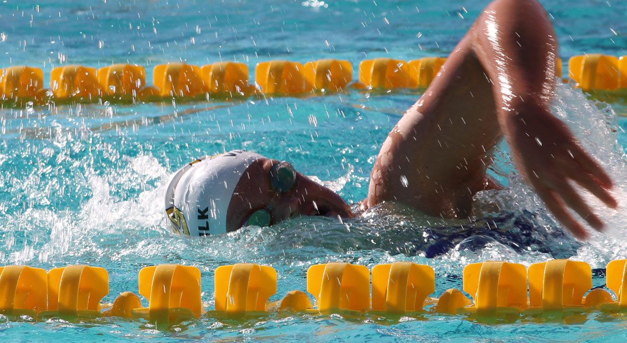 Slug Swimmers Face Challenges in New Conference