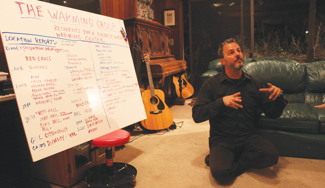Brent Adams, spokesperson for The Warming Center, leads a meeting from his living room. The grassroots movement is quickly gaining momentum throughout the broader Santa Cruz community. Photo by Katie Small.