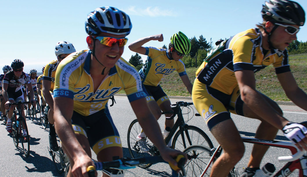 Mark Tingwald  (left) smiles during the first lap of the Men's B team cycling race as Will Curtis, captain of the UCSC mountain biking team, pumps his fist in the air behind him. Tingwald placed sixth and Curtis placed second in the race.  Photo by Katie Small.