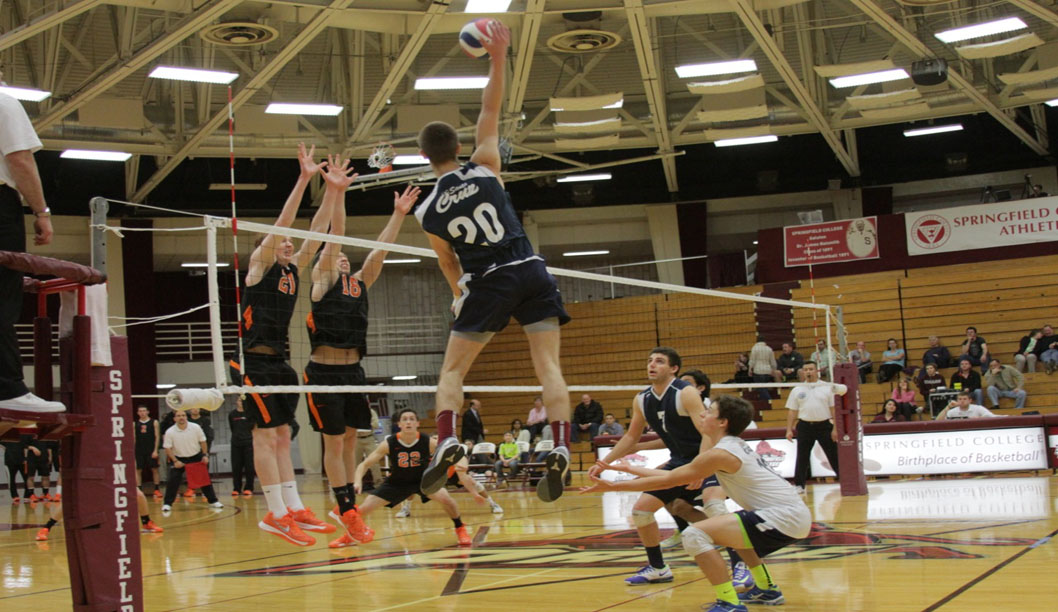 Mark lund makes a kill in a match against MIT.  Lund had four kills in the match. Photo by Todd Hollenbeck.