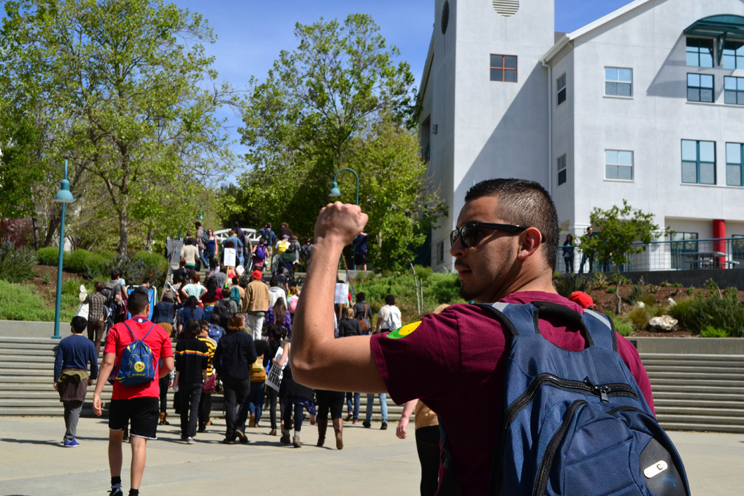 After the rally, one group of about 70 protesters marched through College Eight and Oakes College urging students to join the rally. Photo by Camille Carrillo.