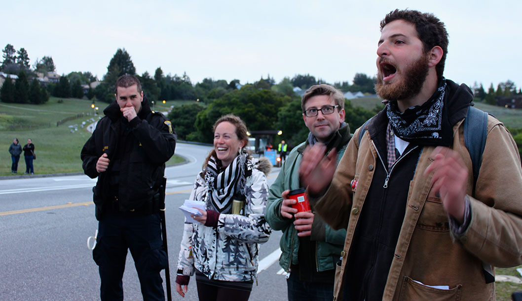 Shortly after protesters received instructions to not harass incoming traffic, a graduate student was arrested for jay-walking against police orders during the United Auto Workers 2865 strike on April 3. Photo by Katie Small.