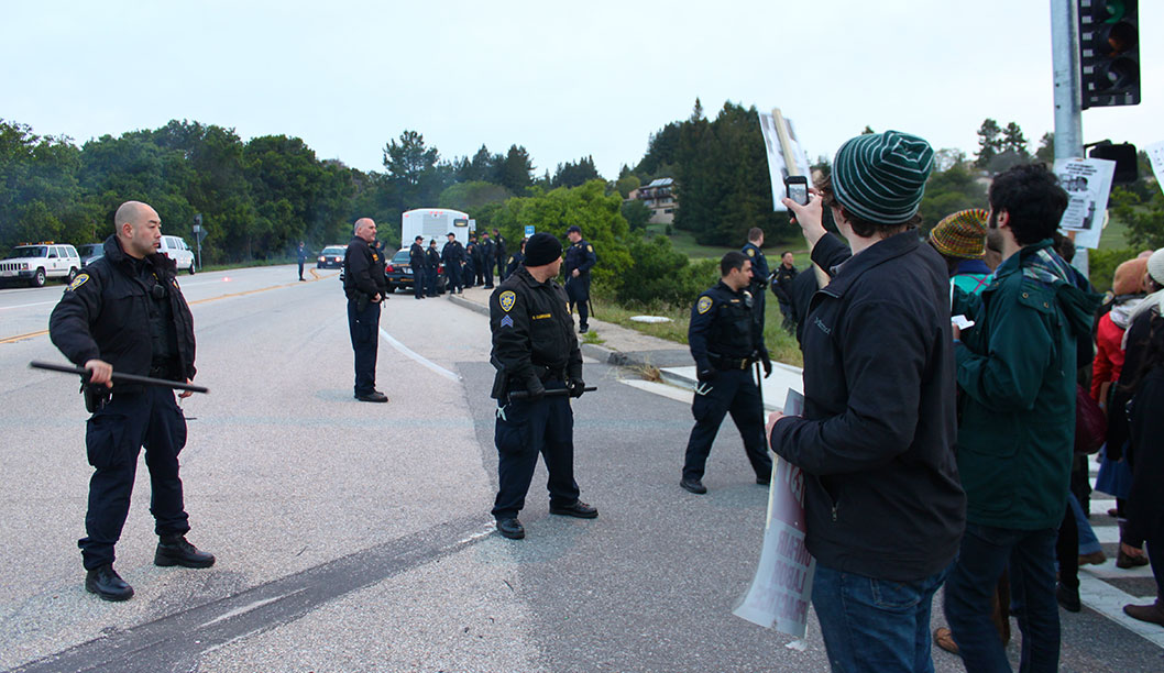 """Protesters recorded the arrest on their phones and began chanting """"fuck the police!"""" during the United Auto Workers 2865 strike on April 3. Photo by Katie Small."""