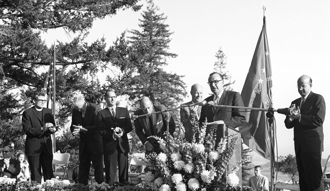 Governor Pat Brown delivers a speech during the opening ceremony in 1964, which took place at Cowell College. Dean McHenry is on his left, and University of California president Clark Kerr is on his right. Photo courtesy of Vester Dick.