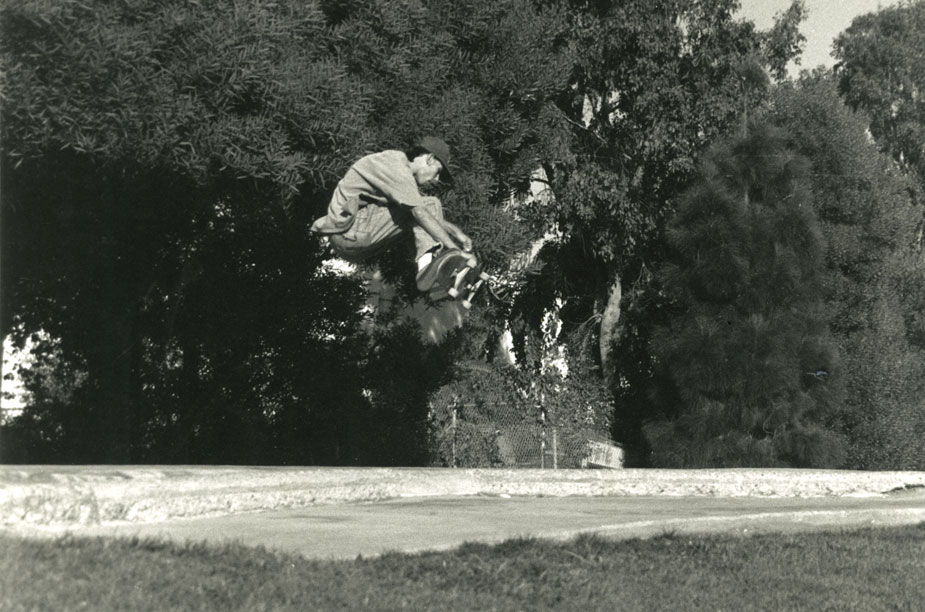 "Santa Cruz local skater launches out of the snake run in 1995 (above). Photo courtesy of Jeromy Hewitt. ""The snake run"" (below) is a long steep embankment connecting the larger bowl to ""the rocket pocket,"" a tight corner used to increase speed before ""the hip."""