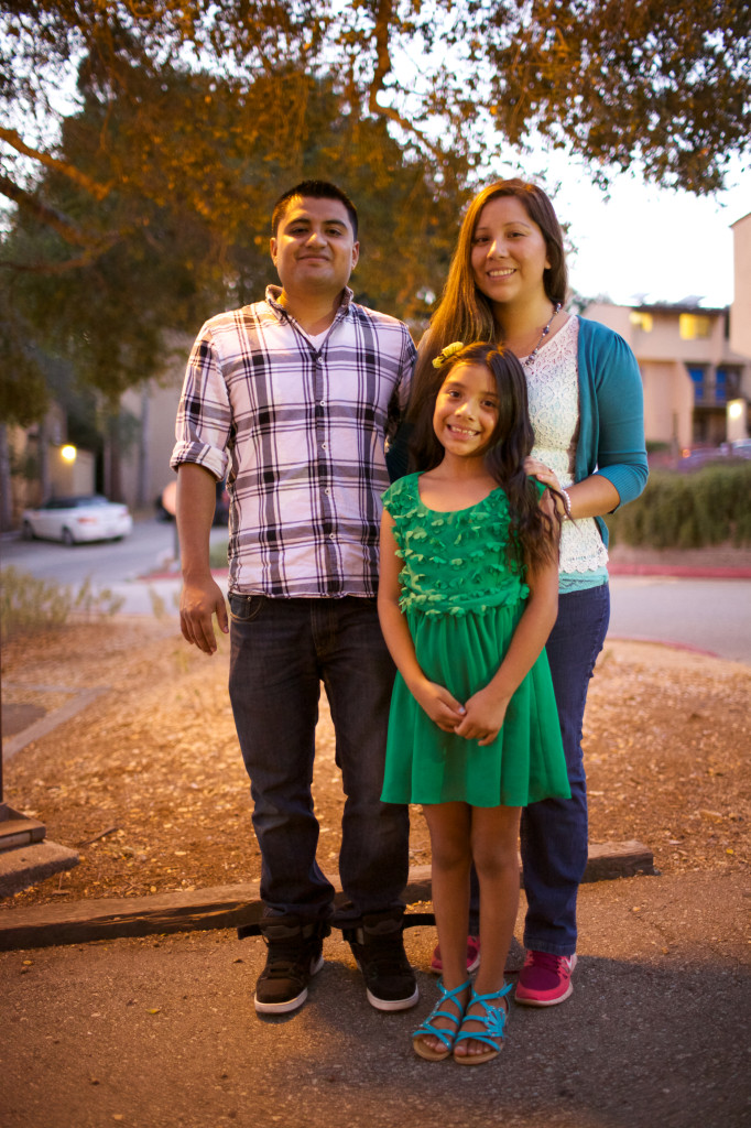 Angel Alvarez and Stephanie Huerta, with their daughter Emily, are going into their fifth year living at Family Student Housing. Between planning their wedding, raising their daughter and Huerta finishing her degree, the pace of their lives has not slowed down. Photo by Alex Posis.