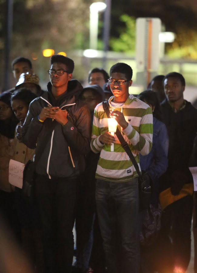 About 100 people gathered at Quarry Plaza on Monday night after the grand jury announced Officer Darren Wilson was not to be indicted after killing unarmed 18 year-old Michael Brown.  Photo by Stephen De Ropp.
