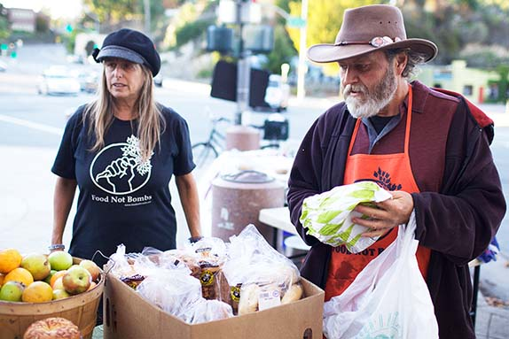 Set up in downtown Santa Cruz, Food Not Bombs co-founder Keith McHenry provides meals and groceries for people who are housless. Photo by Alex Posis.