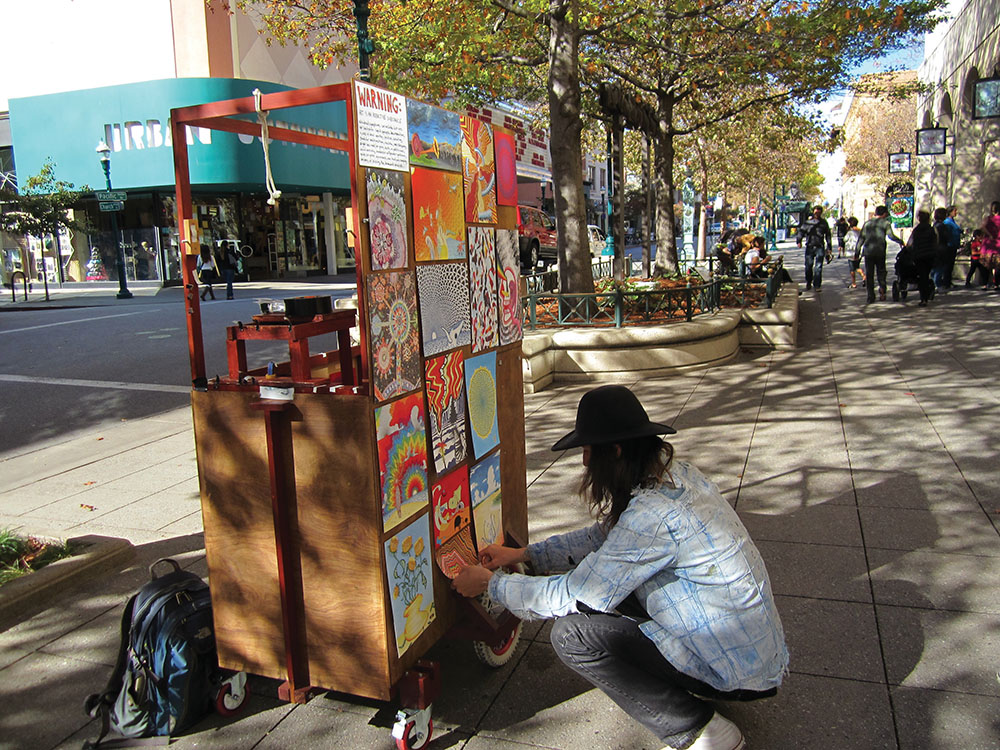 Now designated and time-restricted spaces will give downtown Santa Cruz performers and vendors, such as local art vendor Alex Skelton, new rules to abide by when soliciting on Pacific Avenue. Photo by  Ardy Raghian.