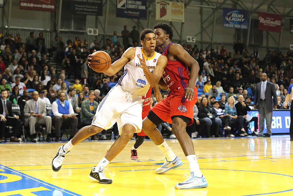 James McAdoo of the Santa Cruz Warriors dribbles past Hasheem Thabeet of the Grand Rapids Drive during the Drive's 100-77 victory last Saturday. Photo by Stephen DeRopp.