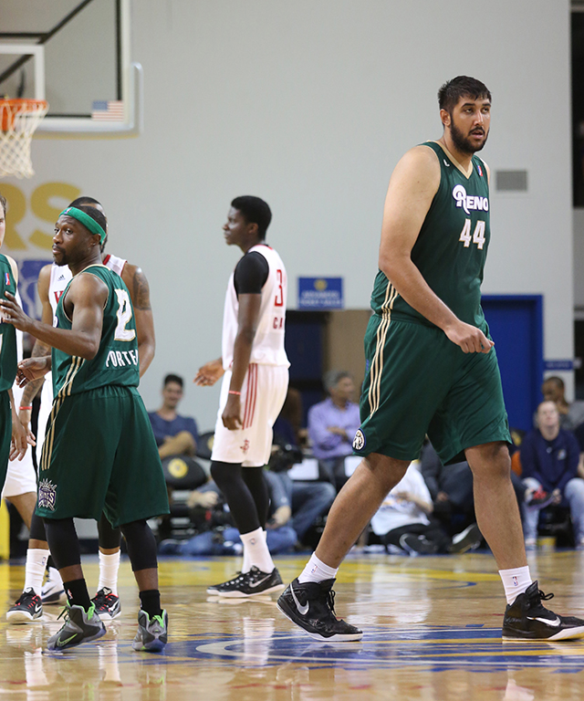 """Tajuan Porter (5'7"""") is dwarfed by his teammate Sim Bhullar (7'5"""").  The two have the greatest separation of height amongst teammates in the NBA D-League.  Over the summer Bhullar made history as the first player of Indian descent to sign with an NBA team. Photo by Stephen DeRopp."""