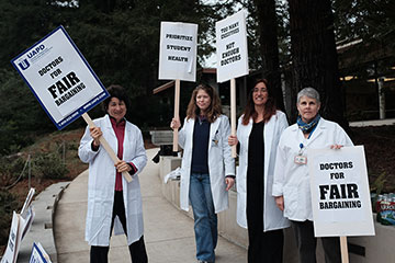 Registered nurse Amy Hamel, Dr. Naomi Silber, Dr. Linda Kirby and Dr. Janie Gleghorn (left to right) form a picket line in front of the Student Health Center. Photo by Alex Posis