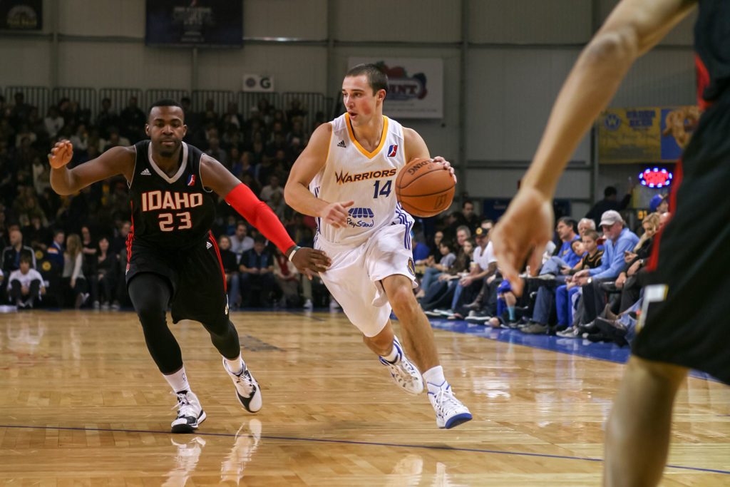 Santa Cruz Warriors guard Aaron Craft drives on Aaron Dotson of the Idaho Stampede during D-League action earlier this season . Photo courtesy of SC Warriors.
