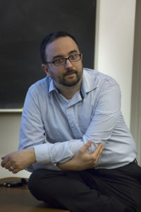 Noah Salomon, assistant professor of religion at Carleton College, delivered a speech on Tuesday night regarding violence in South Sudan.  Photo by Casey Amaral.