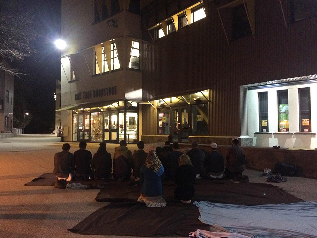 Muslim Student Association (MSA) organized a vigil in Quarry Plaza on Friday night to honor the three Muslim students killed in Chapel Hill, North Carolina on Feb. 10. Photo by Camille Miller.