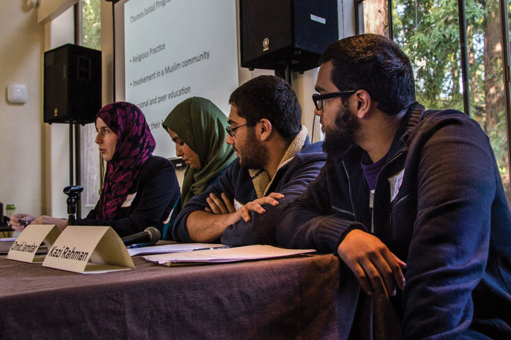 Panelists Ashley Divine, Thooba Samimi, Omid Jamdar and Kazi Rahman presented their experiences as Muslims in college. Their experiences ranged from having trouble finding spaces to pray on campus to finding a community of Muslims at UCSC. Photo by Jasper Lyons.