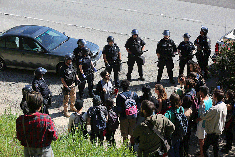 The police told the students they were trespassing and were subject to arrest if they stayed. Photo by Stephen De Ropp.