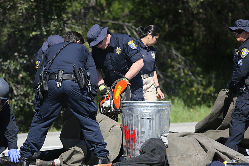 UCPD used a saw to cut the tubes and garbage bins. Photo by Stephen De Ropp.