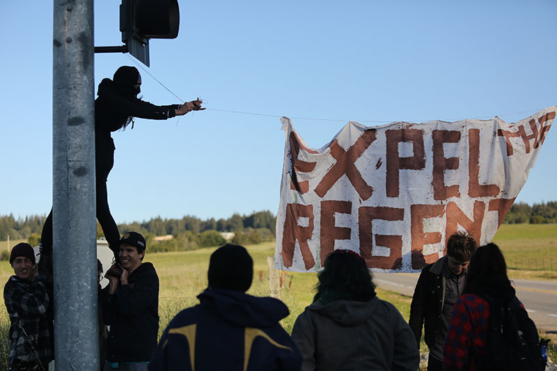 """Students painted this sign, """"Expel the regents"""" before dawn, and used the paint for other banners and signs. Many protesters voiced their frustration with the university's decision to suspend the six UCSC students arrested during the Highway 17 blockage on March 3. The six students are placed on a two-week interim suspension, potentially endangering their ability to pass classes this quarter."""