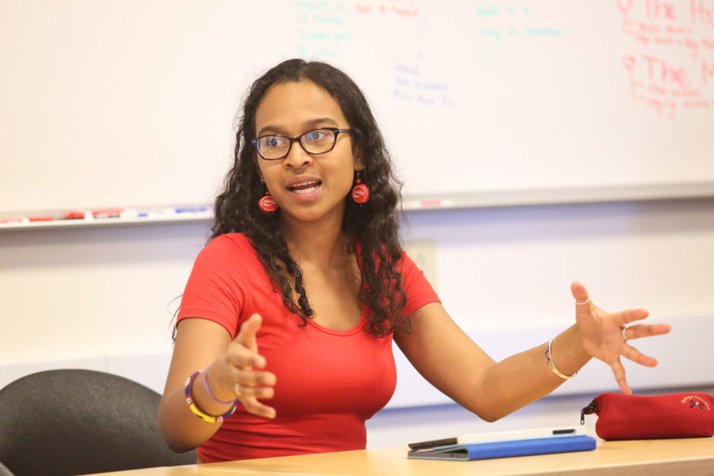 """Abyan Mama-Farah, organizer of """"Bring Back Our Girls Anniversary Day of Global Action"""" at UCSC, discusses the historical, social and political implications of the kidnappings. Photo by Stephen De Ropp"""