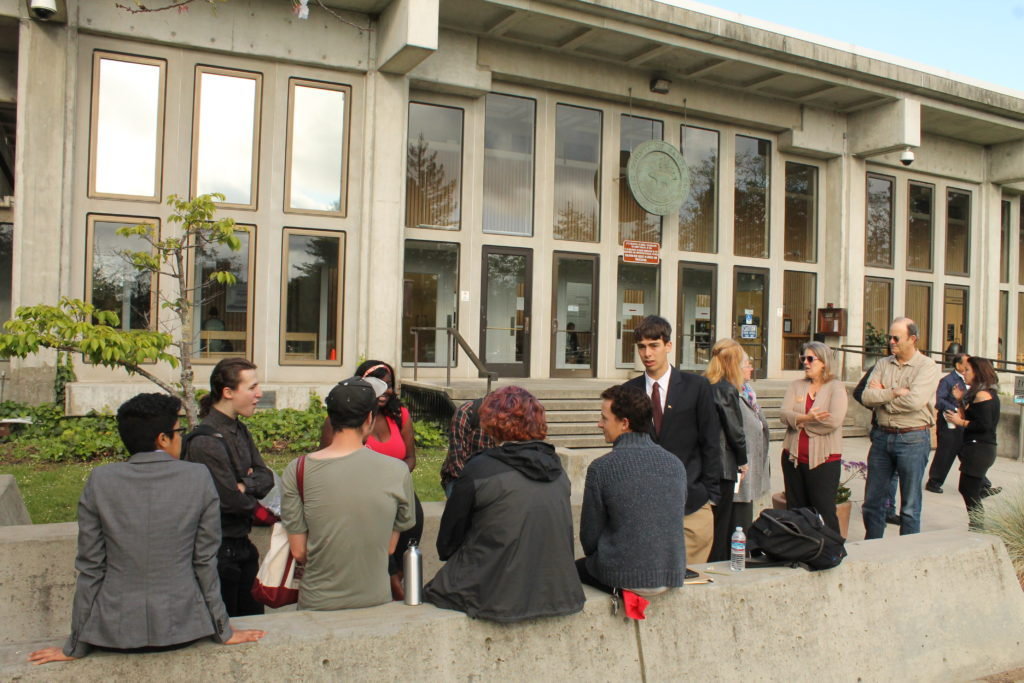 Before the trial hearing, attorneys and defendants waited outside the courtroom. Photo by Dylan Foster.