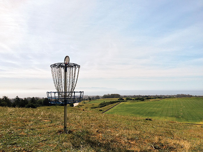 Disc golf is similar to golf, but instead of swinging a club, players throw a disc similar to a Frisbee at a basket suspended about three feet from the ground. Photo by Alex Posis.