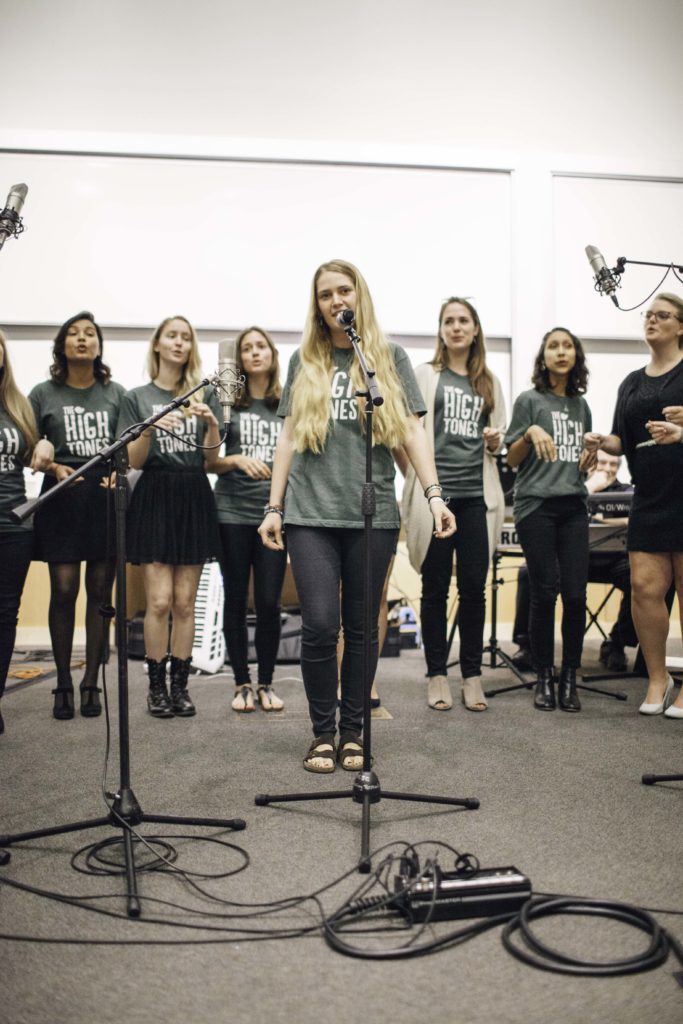 """Members of the Hightones perform a mashup of the Beach Boys hit """"California Girls"""" and Katy Perry's """"California Gurls"""" at the Dizikes Concert: Sounds of the Times on April 26 during Alumni Weekend. They will perform on the second day of Acquirefest. Photo by Alex Posis."""