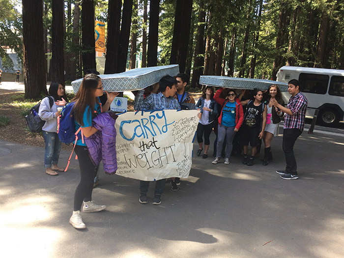 """As a part of """"Carry That Weight,"""" students hefted mattresses in support of victims of sexual abuse. The demonstration took place on April 13, the national day of action to call for changes to how campuses prevent and respond to sexual violence. Photo by Dylan Foster."""