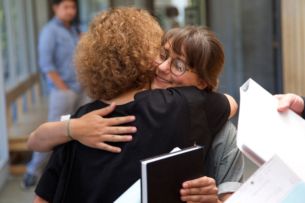 "Sophia Dimatteo hugs her mother outside the courtroom after the hearing. Her mother read a statement, which described her daughter as ""always passionate about making her community a better place."" Photo by Jasper Lyons."