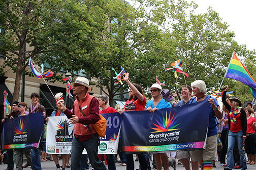 """Representatives from the Santa Cruz Diversity Center march down Pacific Avenue at last year's PRIDE celebration. Last year's theme, """"Pride Marches On, Celebrating Trailblazers,"""" commemorated influential preceding participants who marched and fought for equality in the community. Stock Photo."""