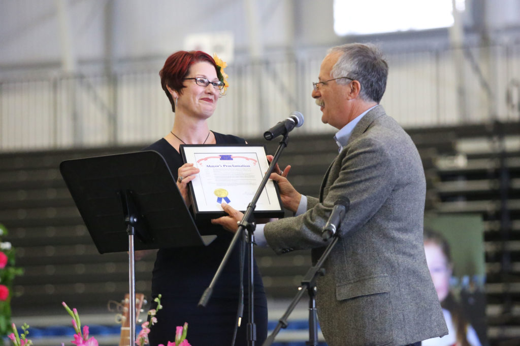 Santa Cruz Mayor Don Lane presents a Mayor's Proclamation to Maddy's mother, declaring Oct. 5 Maddy Middleton Day. Photo by Stephen De Ropp.