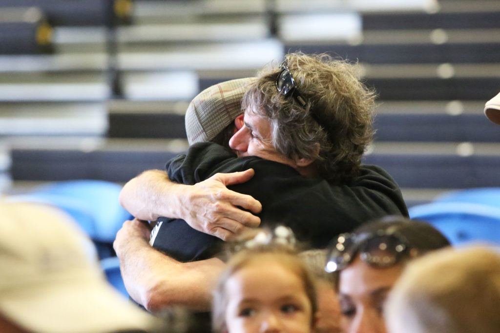 Maddy's father, Michael Middleton, is comforted by family members and friends. Photo by Stephen De Ropp.