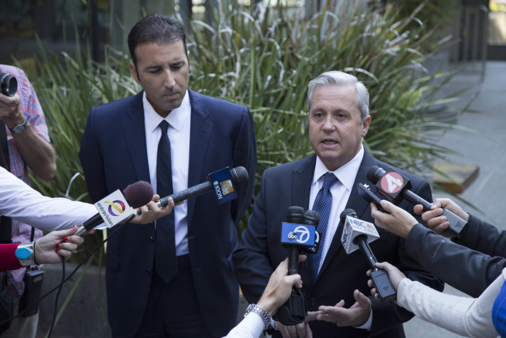 District Attorney Jeff Rosell  (right) and Deputy District Attorney Rafael Vasquez (left) address the media. Photo by Jasper Lyons.