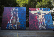 On Wednesday, six 8 foot-by-8 foot paintings displayed across UCSC campus to engage students in political discussion.