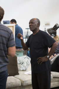 """Artist Raymond Saunders displays his mixed-media painting series, """"Black is a Color"""", at the Sesnon Gallery. Saunders hosted a painting workshop last Friday with art students to promote his work and interact with the students."""