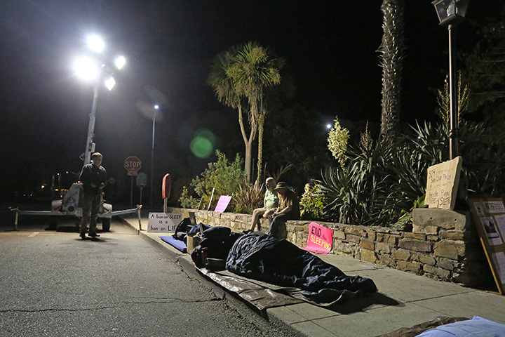 In addition to police ticketing, the City of Santa Cruz has employed private security guards and high-powered lighting in an effort to deter people from sleeping in front of the Santa Cruz City Hall. Photo by Stephen de Ropp.