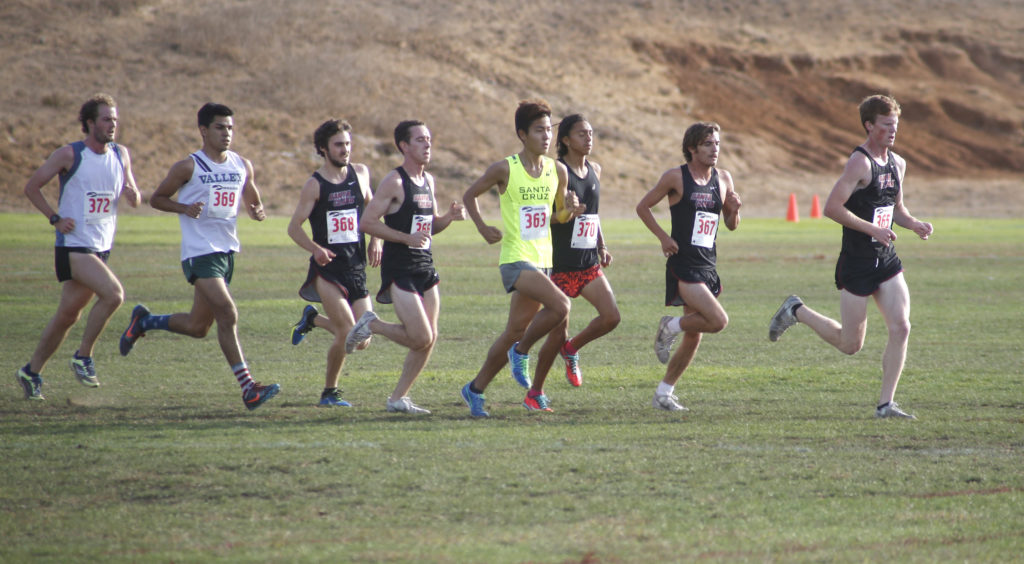 The UCSC Men's Cross Country Team competed against Santa Clara University on UCSC's East Field in an 8K meet. Photo by Calyse Tobias