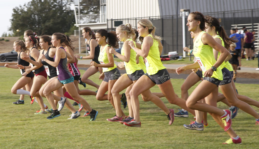 The women's teams begin their 5K race around the East Field.