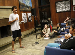 Christopher Dory, a first-year student from College Nine, delivers one of his poems. Photo by Calyse Tobias.